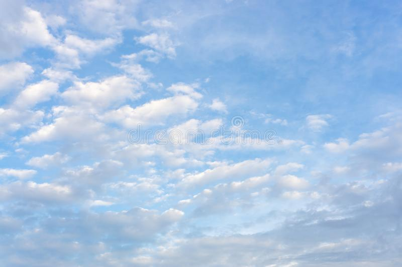 Beautiful form of white fluffy clouds on vivid blue sky in a suny day. Upward view royalty free stock photos