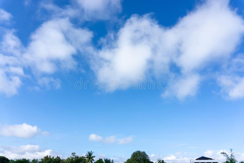 Beautiful form of white fluffy clouds on vivid blue sky in a suny day. For background royalty free stock image