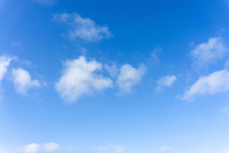 Beautiful form of white fluffy clouds on vivid blue sky in a suny day. For background stock photography