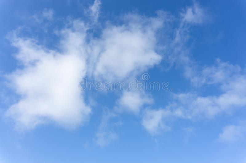 Beautiful form of white fluffy clouds on vivid blue sky in a suny day. For background stock photo