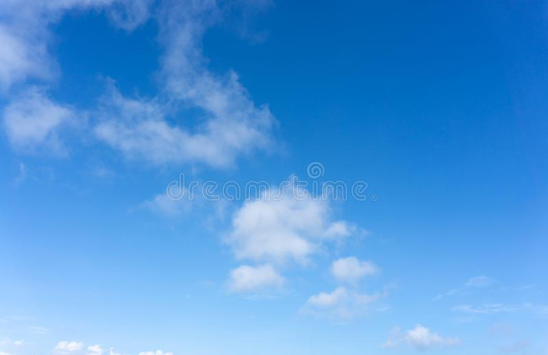 Beautiful form of white fluffy clouds on vivid blue sky in a suny day. For background stock photos