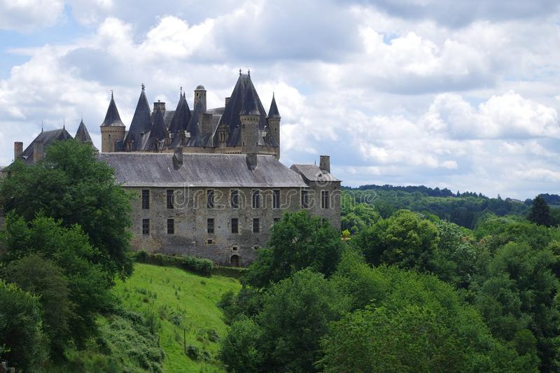 Beautiful fortress, castle on top of a hill and hidden by a rich surrounding forest. royalty free stock photography
