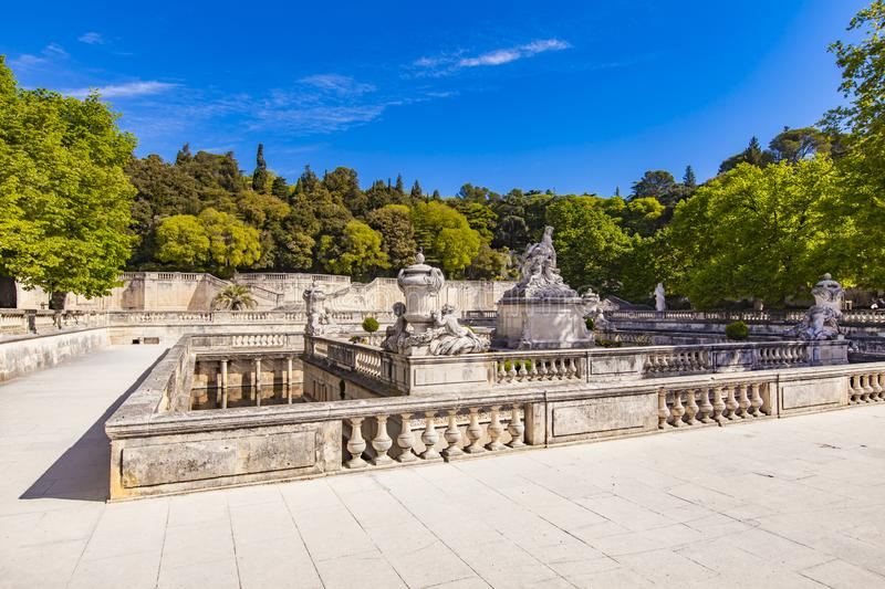 A beautiful fountain in the Jardin de la fontaine in Nimes, France royalty free stock photography