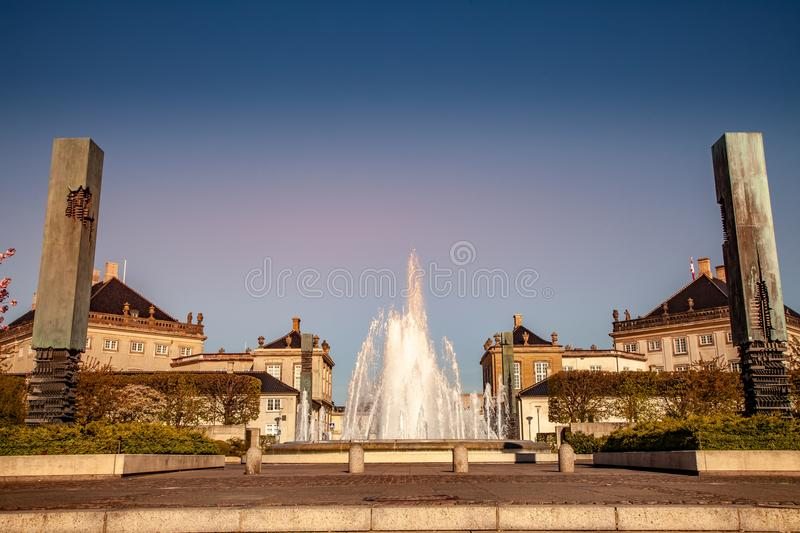 beautiful fountain and monuments on historical square royalty free stock photo