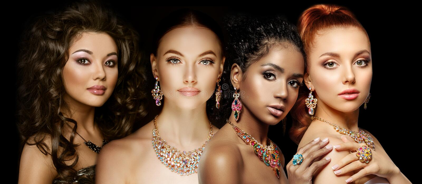 Beautiful Four models girls with set of Jewelry. Luxury girls in shine jewellry: Eearrings, Necklace, and Ring. Women in jewelry. From Gold, Precious Stones royalty free stock images