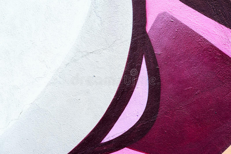 Beautiful fragment of wall with detail of graffiti, street art. Abstract creative drawing fashion colors on the city royalty free stock photos