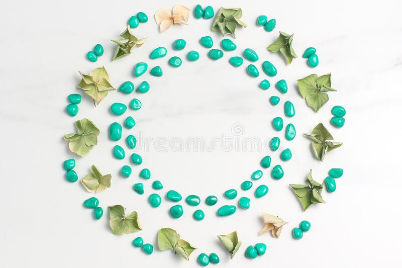 Beautiful frame of dried flowers of hydrangeas and pebbles of turquoise color. Marble background. View from above, flat lay royalty free stock photos
