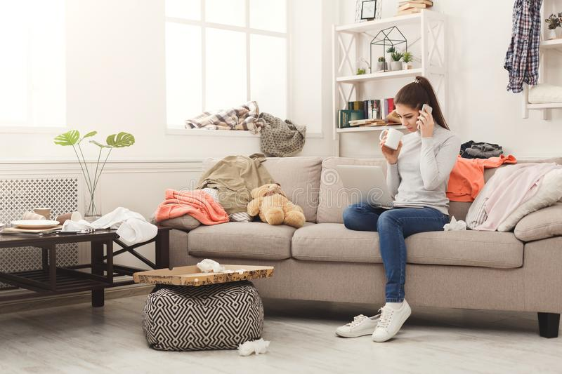 Beautiful freelancer working at messy home royalty free stock images