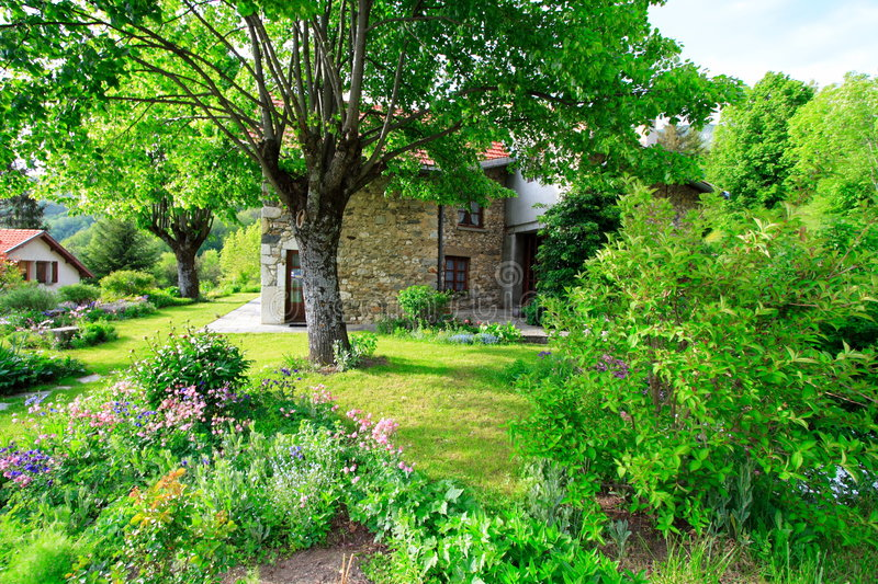 Beautiful french garden. Beautiful garden in the the french countryside with an old typical house stock photography
