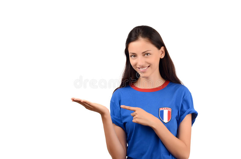 Beautiful French girl pointing and showing. stock photos