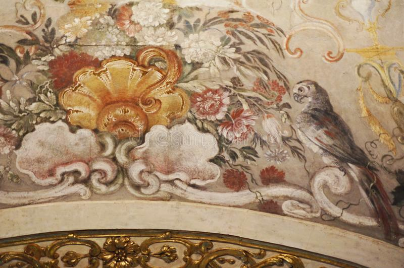 Italy Turin royal palace palazzo Madama fresco with exotic flowers and parrot stock photo