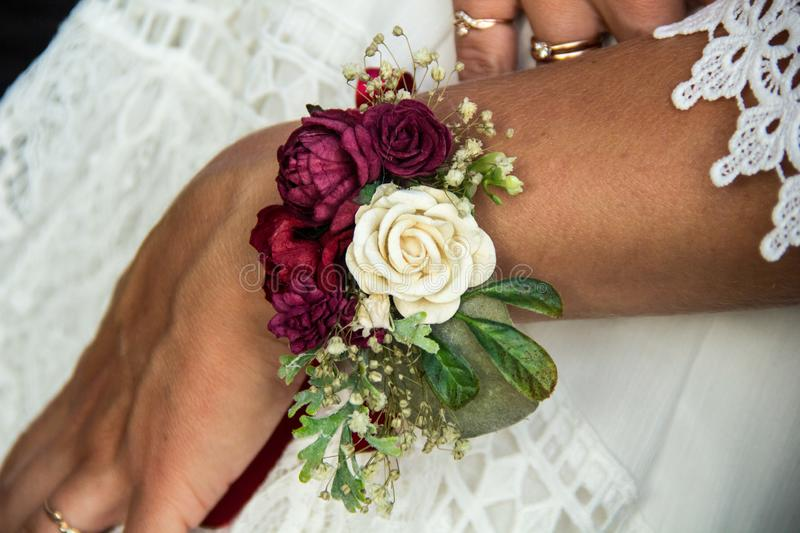 Beautiful fresh floral bracelet for the bride. wedding accessory with roses. Beautiful fresh floral bracelet for the bride. wedding accessory with white and red stock photo