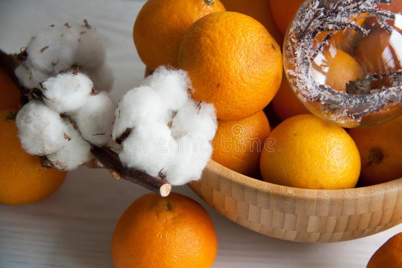 New Year decoration: orange mandarins, Christmas tree toy and cotton stock photo