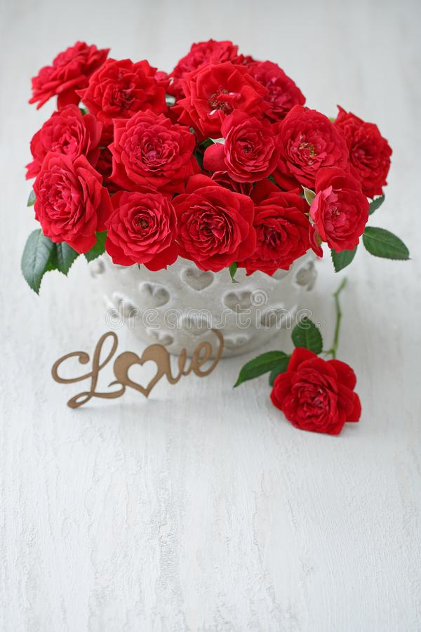 Beautiful fresh red roses flowers . Lovely bunch of flowers .Beautiful fresh roses flowers in a vase royalty free stock photography