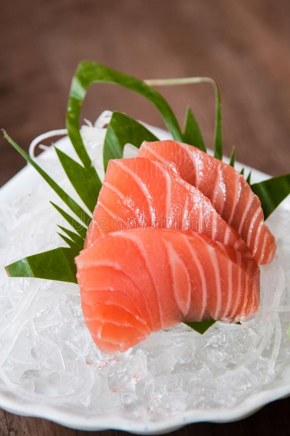 Fresh salmon sashimi on ice. Beautiful Fresh salmon sashimi on ice stock image