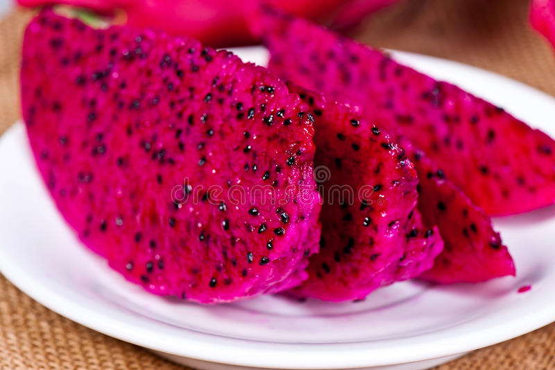Beautiful fresh sliced red dragon fruit (pitaya) royalty free stock images