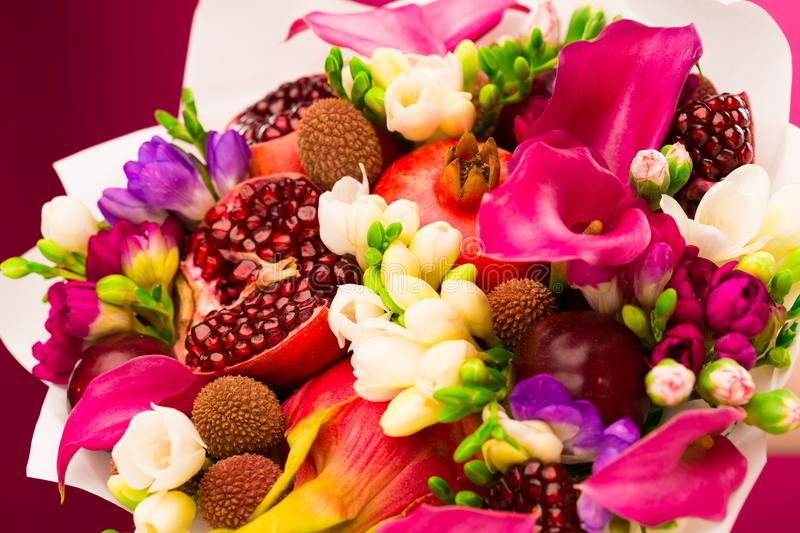 Flowers, fruit bouquet, pink callas, garnet, lychees, freesia, p. Beautiful fresh spring exotic fruit flowers tropical bouquet: pink callas, garnet, lychees stock images