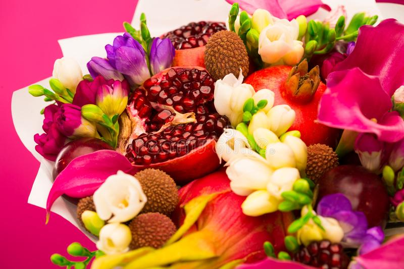 Flowers, fruit bouquet, pink callas, garnet, lychees, freesia, p. Beautiful fresh spring exotic fruit flowers tropical bouquet: pink callas, garnet, lychees stock photo