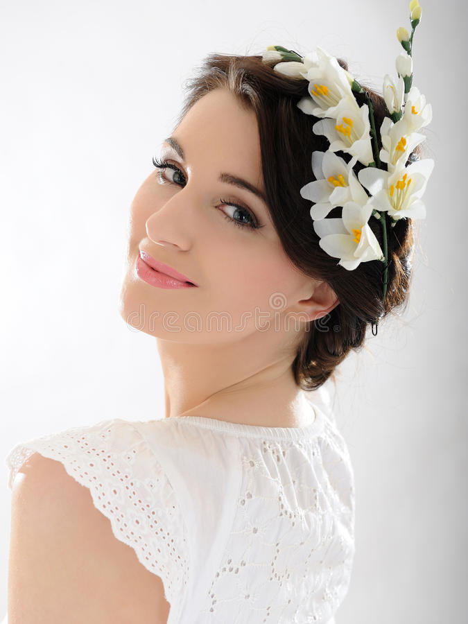 Beautiful fresh spring woman. With flowers in her hair stock photo