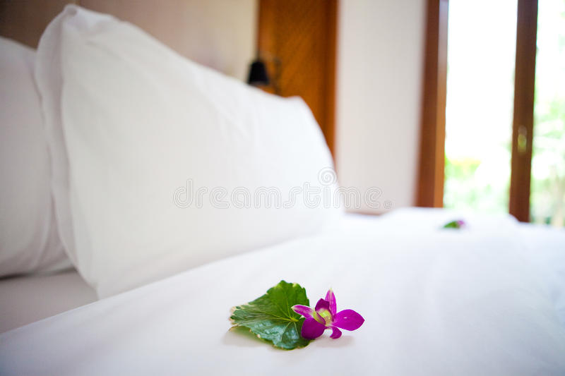 Beautiful freshly made bed royalty free stock photos