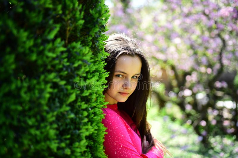 Beautiful freshness. Young lady in spring garden. Cute girl on spring nature. Pretty girl with young face skin and no. Makeup. Beauty model with fresh look royalty free stock photo
