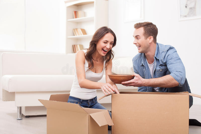 Beautiful friendly family is moving in new stock photography