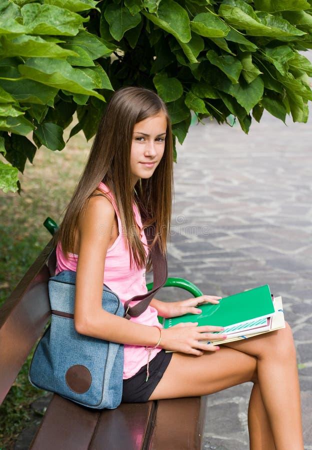 Beautiful friendly teen student girl.