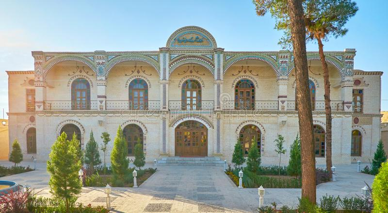 Modern edifice in old town of Yazd. Beautiful frontage of modern edifice with small garden located in the heart of old town in Yazd, Iran royalty free stock photography