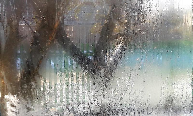 Beautiful Closeup Winter Window Pane Coated Shiny Icy Frost Patterns.. Frozen window glass, morning frost drawings on. Beautiful frosty patterns on the window at stock images