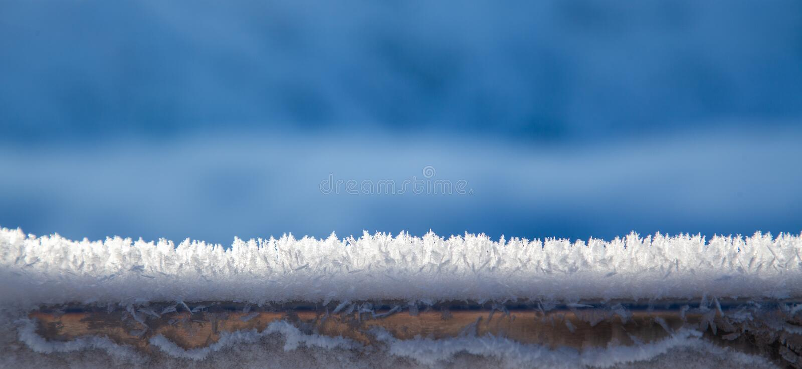 beautiful frozen snowflakes Christmas background stock images