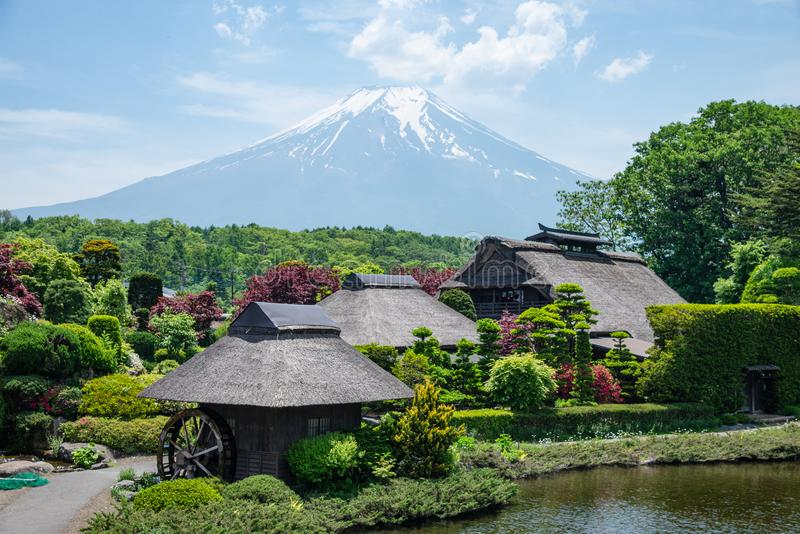 Beautiful Fuji mountain with cloud and blue sky  in the summer at Oshino Hakkai the old Japanese village in Japan stock image