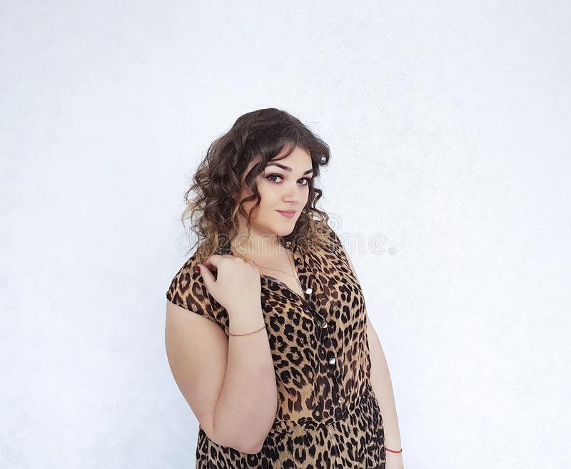 Beautiful full girl in a tiger dress emotions portrait pretty. Beautiful full girl in a tiger dress portrait confident pretty emotions stock photography