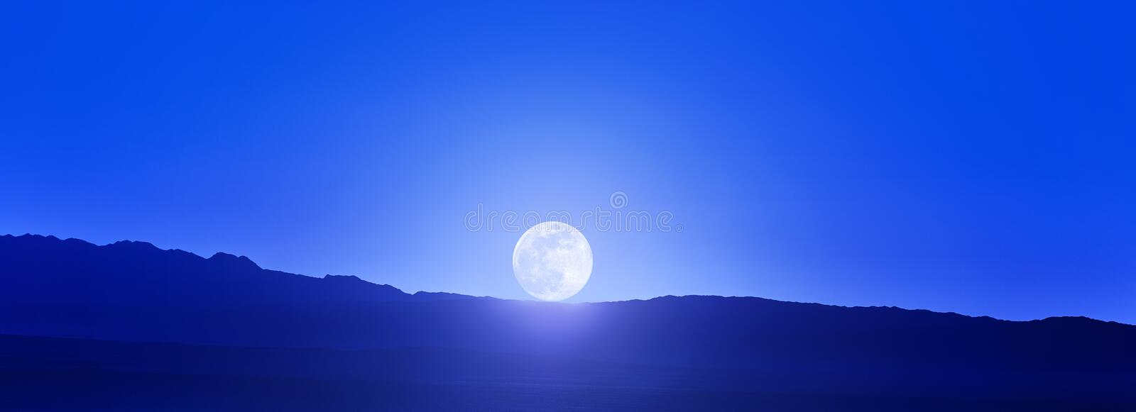 Beautiful Full Moon over the mountains. Moonrise in the mountains. Contour of the mountains and Disk of the moon.  stock images