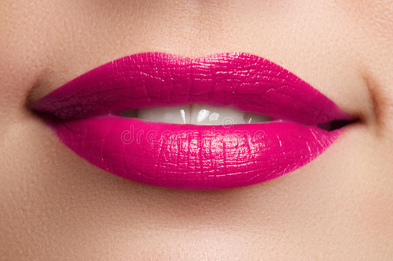 Beautiful full pink lips. Pink lipstick. Make-up and cosmetics stock images