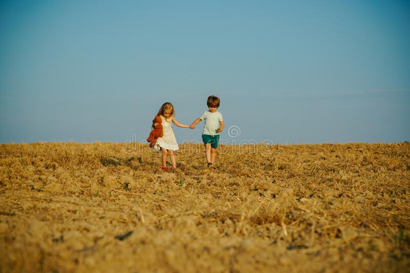 Beautiful fun day for cute friends in nature. Children has summer joy. Children play outdoors. While having fun outdoors royalty free stock image