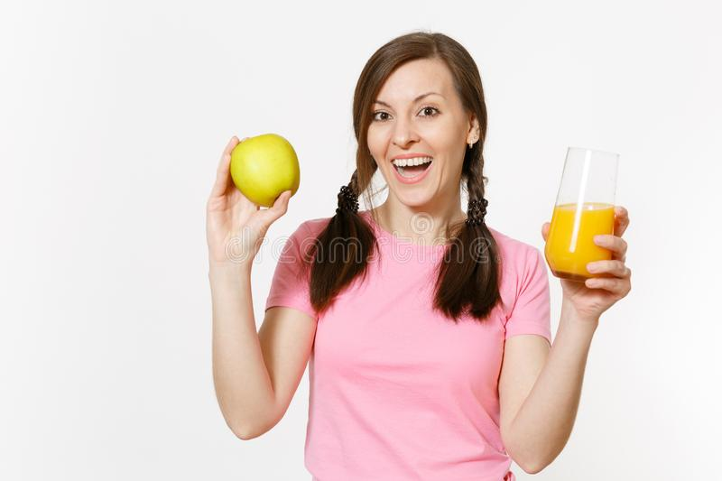 Beautiful fun happy woman holding in hands green apple and orange fresh juice in glass isolated on white background stock image
