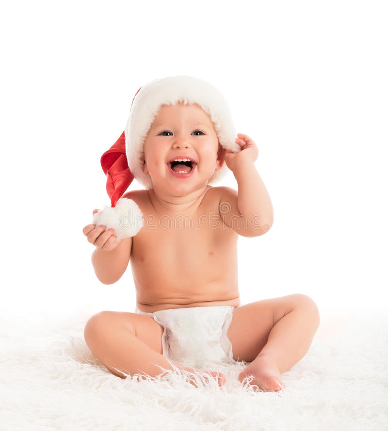 Beautiful funny baby in a Christmas hat isolated on white stock image