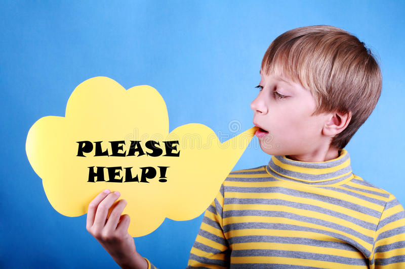 Beautiful funny blond boy holding a message please help! royalty free stock photo
