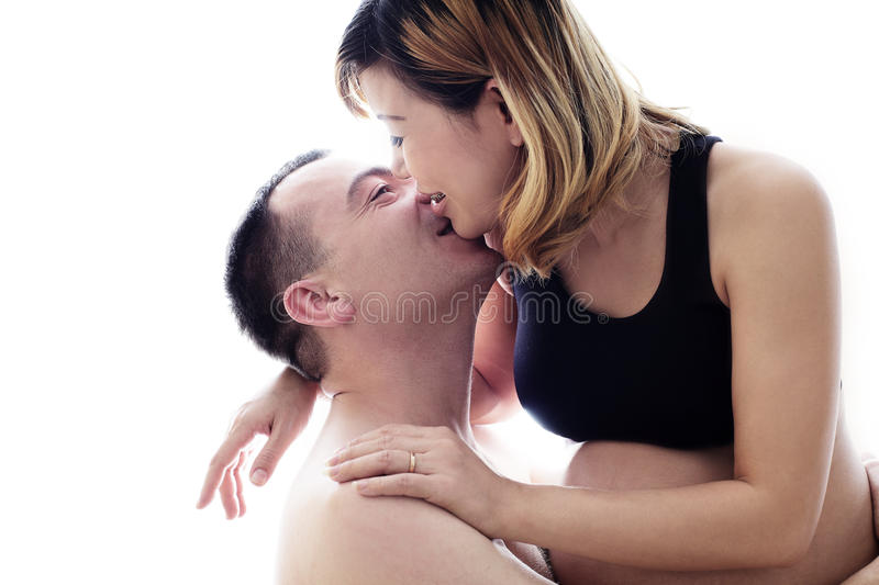 Beautiful future parents: his pregnant asian wife and a happy husband with new life stock photography