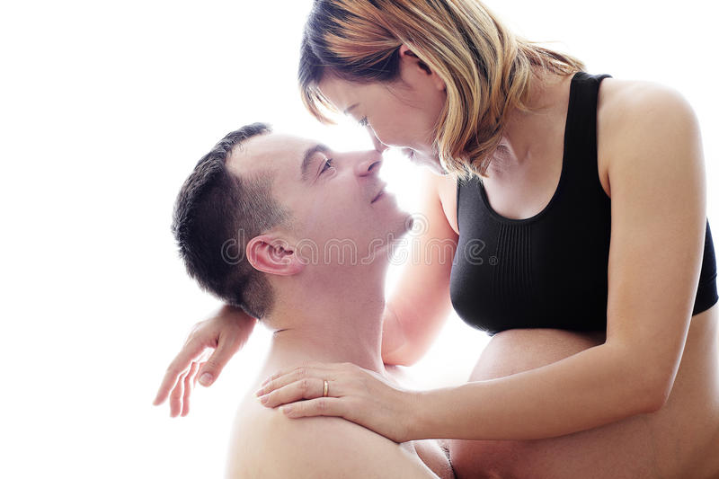 Beautiful future parents: his pregnant asian wife and a happy husband with new life royalty free stock photography