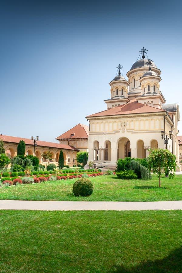 The Coronation Orthodox Cathedral inside Fortress of Alba Iulia, Transylvania, Romania. Beautiful garden around The Coronation Orthodox Cathedral inside Fortress stock photo