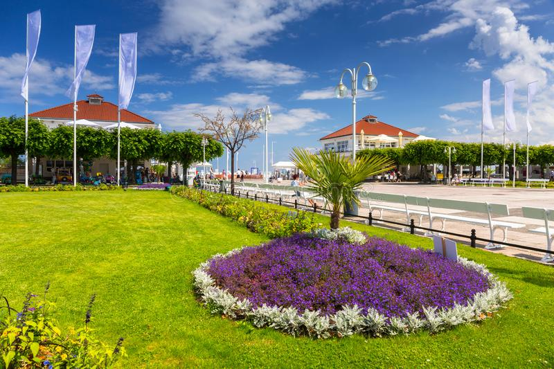 Beautiful garden by the Baltic sea in Sopot, Poland. Summer, promenade, beach, people, square, blue, sky, sunbathing, holiday, vacation, city, travel royalty free stock photo