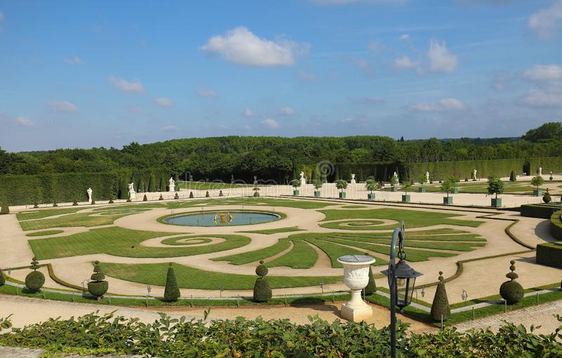 Beautiful garden in a Famous palace Versailles. The Palace Versailles was a royal castle . Paris, France. royalty free stock photo