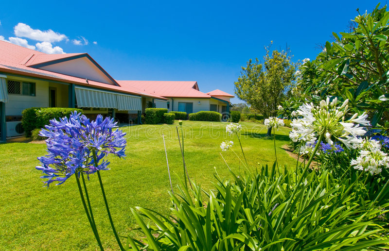 Beautiful gardens at back of house stock photos