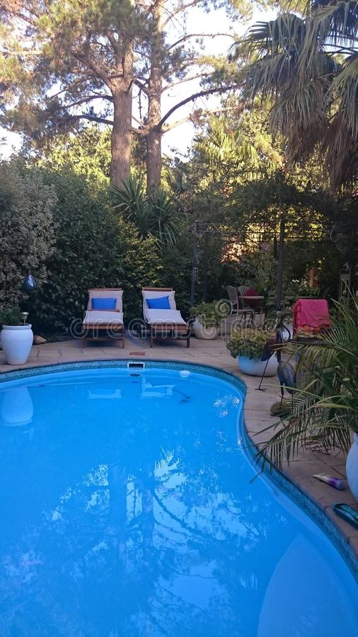 Beautiful gardens and swimming pool stock images