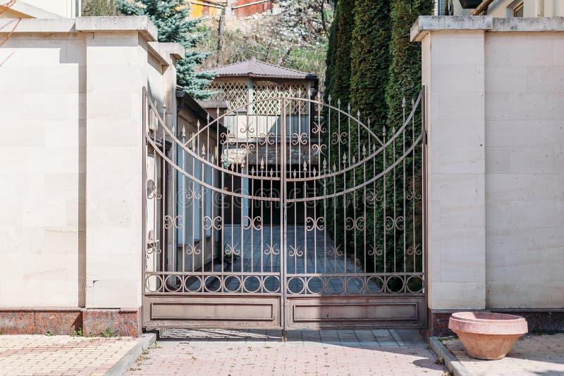 Beautiful gate to elegant house royalty free stock images