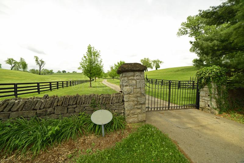 Beautiful gated entrance to farmhouse in Kentucky. Beautiful gated entrance to farmhouse in rural Kentucky royalty free stock images