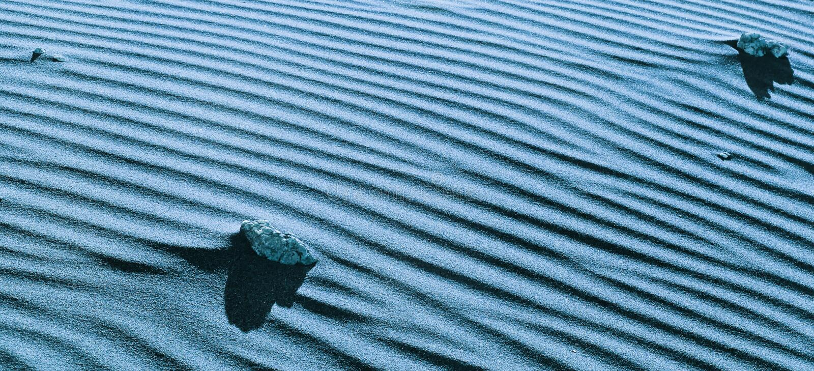Beautiful geometric pattern of sandy dune close up. Abstract natural desert landscape. Texture of sand. Toned panoramic desert background. Copy space for your royalty free stock photo