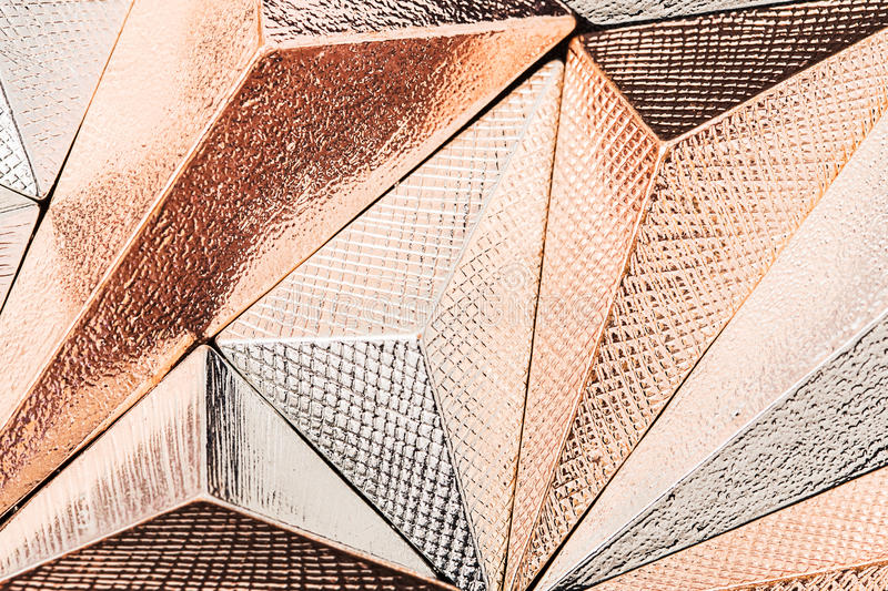 Beautiful geometric three dimensional metal abstract. In studio stock photography