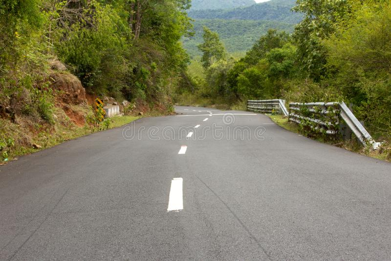 Beautiful Ghat road along the mountain range of Talamalai Reserve Forest, Hasanur, Tamil Nadu - Karnataka State border, India. Hasanur is a town in Talamalai royalty free stock image